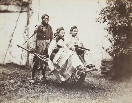 Portrait of two Chinese ladies on Wheelbarrow