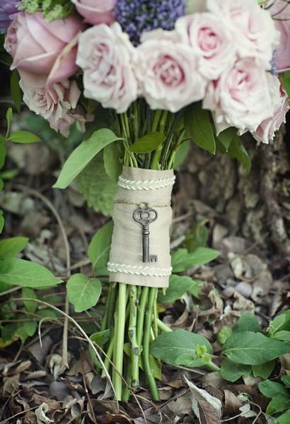 It would be cute to incorporate a key into the bouquet wrap.. with some flowy silk ribbons,- not the way it is shown here.