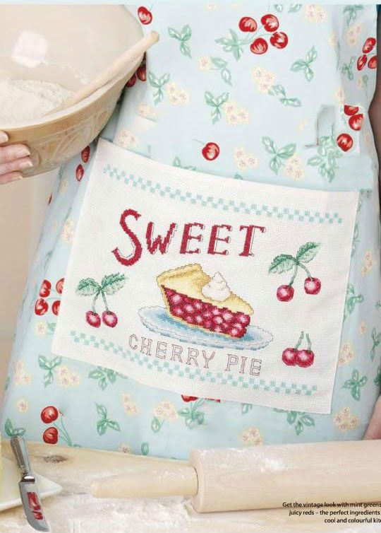 "Cross-stitch design for apron""Cook's pinny"".If you're looking for a gift to make a food lover smile, stitch up a treat with our tasty cherry apron."