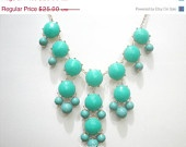 Free Necklace W/ Purchase:  Bubble Necklace,  Bauble Necklace, Turquoise Bubble Necklace, J Crew Inspired, Turquoise Chunky Necklace. $20.00, via Etsy.