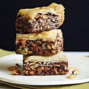 Chocolate Baklava - CookingLight.com  This is a simply amazing recipe—layers of crisp phyllo interspersed with mixed nuts and hazelnut-chocolate spread, with just enough butter to enhance the flavor yet keep the sat fat low. Lightly spiced honey syrup gives the gooey, sticky quality that makes baklava so heavenly.