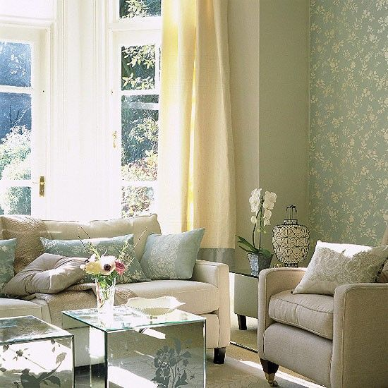 Create a summery feel in your living room, with a wall of floral wallpaper from Villa Nova. Keep the colour palette simple with a cream coloured sofa from the Sofa Workshop and mirrored cubes to reflect light from Laura Ashley. The overall bright, airy feel is completed with neutral curtains to allow the sunlight to flood in.