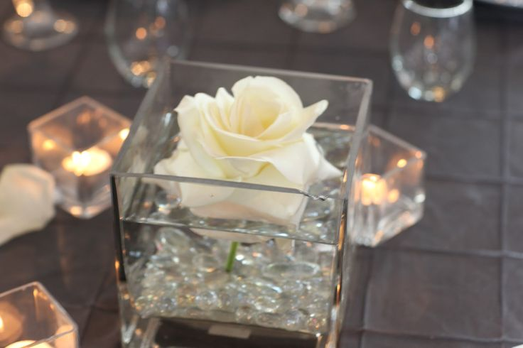 wedding centerpiece, simple elegant, perhaps two of these with two colored flowers on each table.
