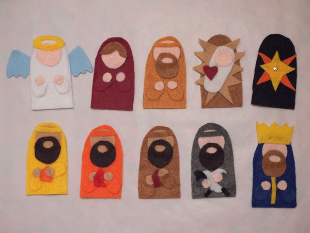 Pink Stripey Socks: DIY Felt Nativity Finger Puppets with Pattern. Probably better to sew the front and back rather then hot glue, but looks great!