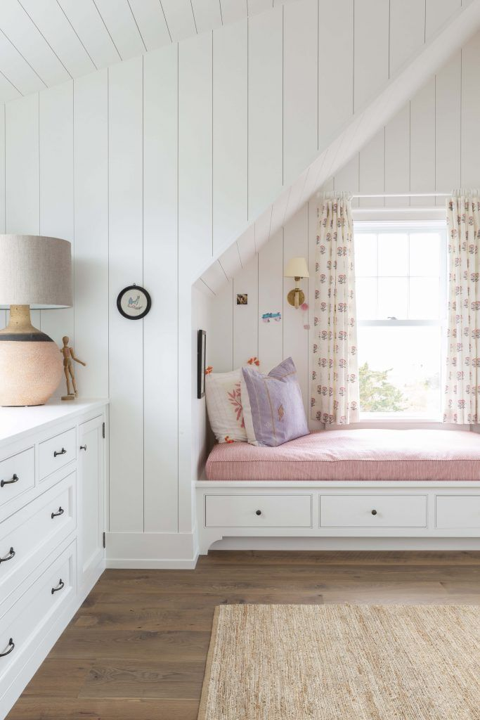 Vertical shiplap in white + window bench seat + pink