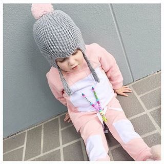 Baby Legging Co Pink Peony Jumper with white square detail Each square is distressed and unique Made with warm Fleece. Adjustable drawstring hem. Zip Closure o