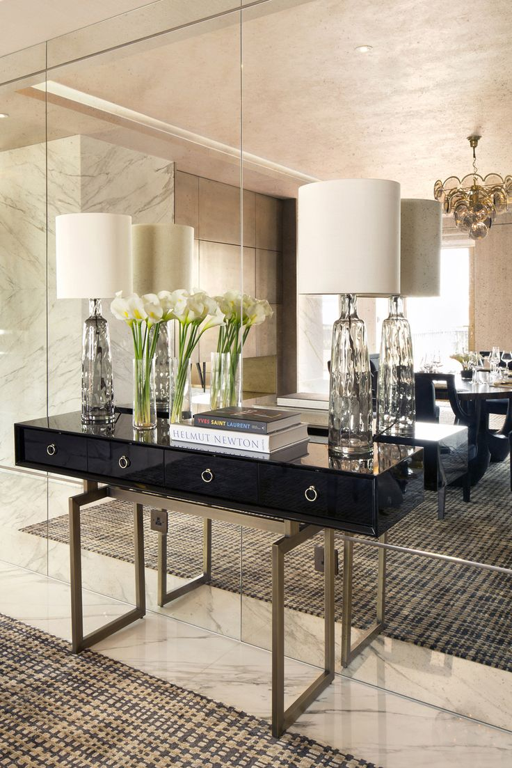 The modern sideboard in this hallway creates a contemporary look and the mirror gives a feeling of space.
