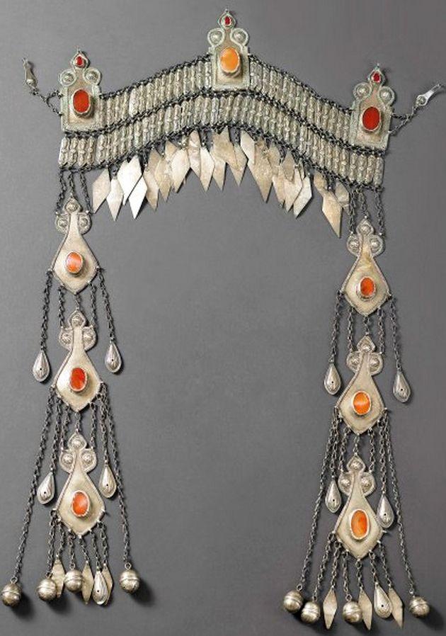 Turkestan | Frontal head ornament ~ sinsileh ~ from the Ersari people.  Silver, silver gilt and carnelians |  ca. 20th century