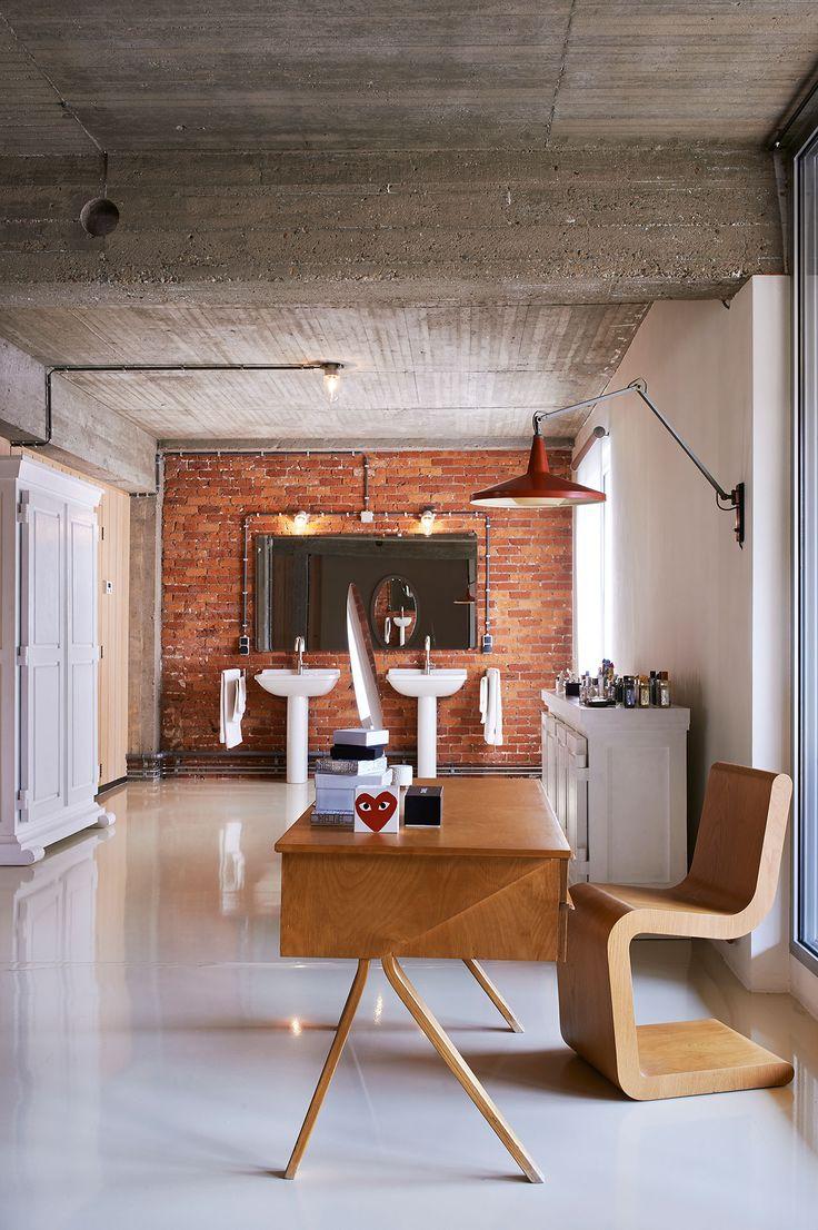 Bathroom. Cabinet: Paper Cupboard (special), Studio Job, 2005.Buffet: Buffet Paper (special), Studio Job, 2005. Wall lamp: Panama, Gispen, Wim Rietveld, 1955. Office: Pastoe, Cees Braakman, 1954.Chair: Curved Chair, Studio Job, 1998.Photo by Dennis Brandsma.