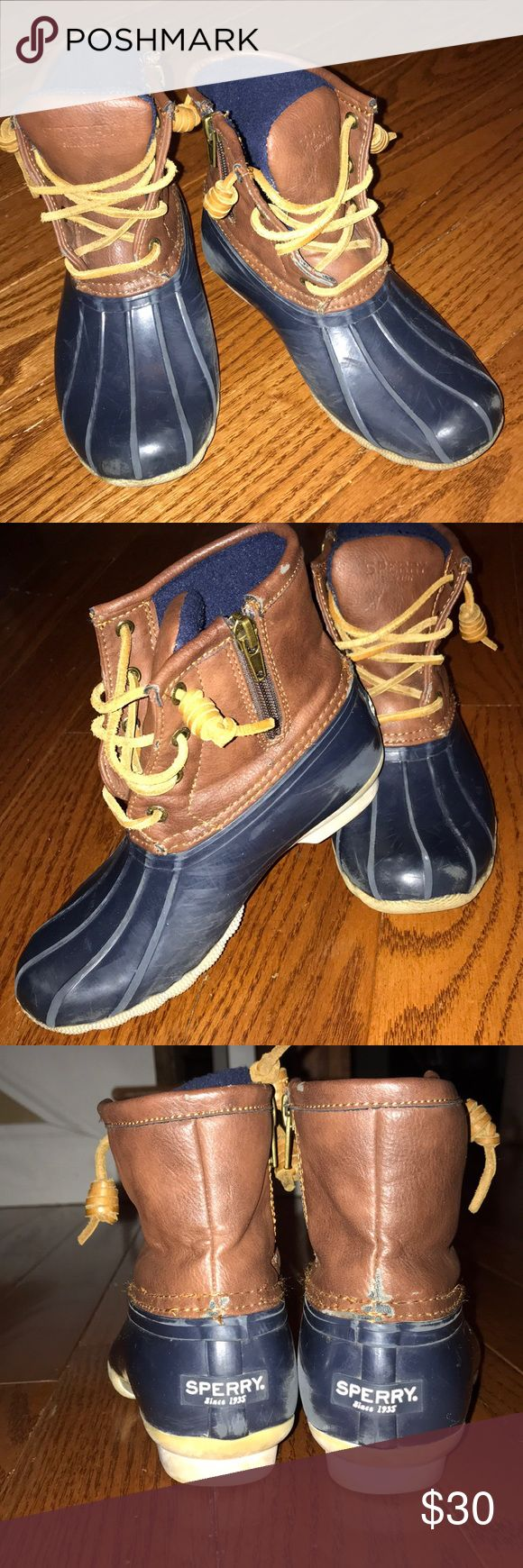 Girls navy Sperry boots size 1 Girls Sperry saltwater boots. Navy. Size 1 little girls. In good used condition. Scuffing on the inner side due to boots rubbing together while walking. Sperry Top-Sider Shoes Rain & Snow Boots