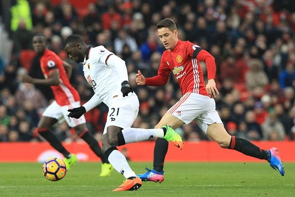 Manchester United's Spanish midfielder Ander Herrera chases Watford's French striker M'Baye Niang during the English Premier League football match...