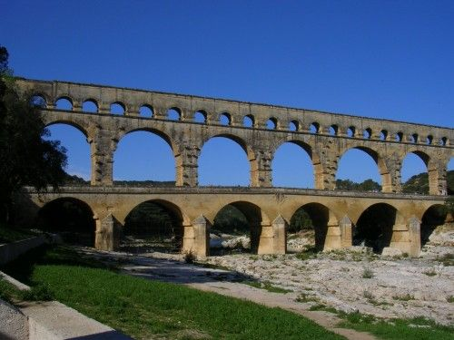 Aqueducts we're used in many different countries. They were first used in Greece as an underground way to provide water to drinking fountains. The Romans were famous for their aqueducts, which were large arcs that brought water all over the place, like to public baths and decorative fountains.