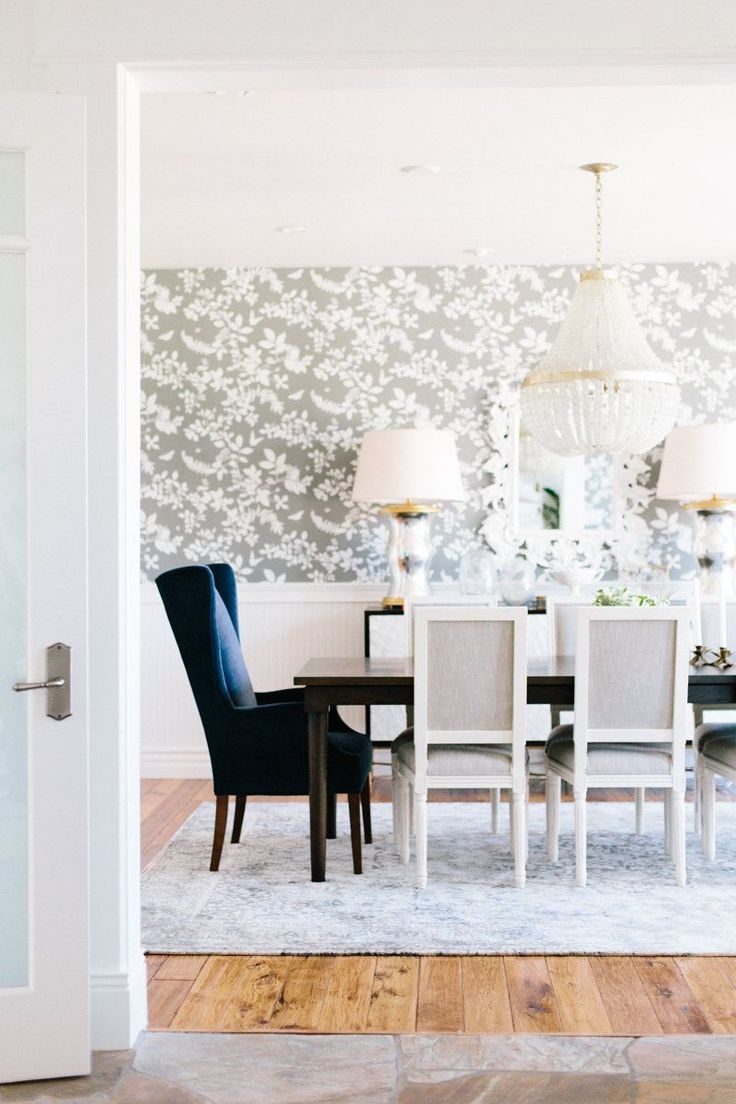 Dining room with navy wingback chairs and gray floral wallpaper || Studio McGee