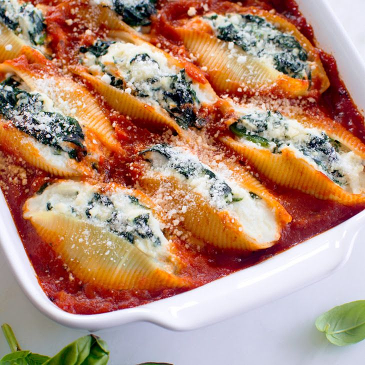 Spinach and Ricotta Stuffed Shells Recipe Main Dishes with jumbo pasta shells, olive oil, garlic, fresh spinach leaves, ricotta cheese, mozzarella cheese, grated parmesan cheese, large eggs, fresh basil, kosher salt, ground black pepper, marinara sauce