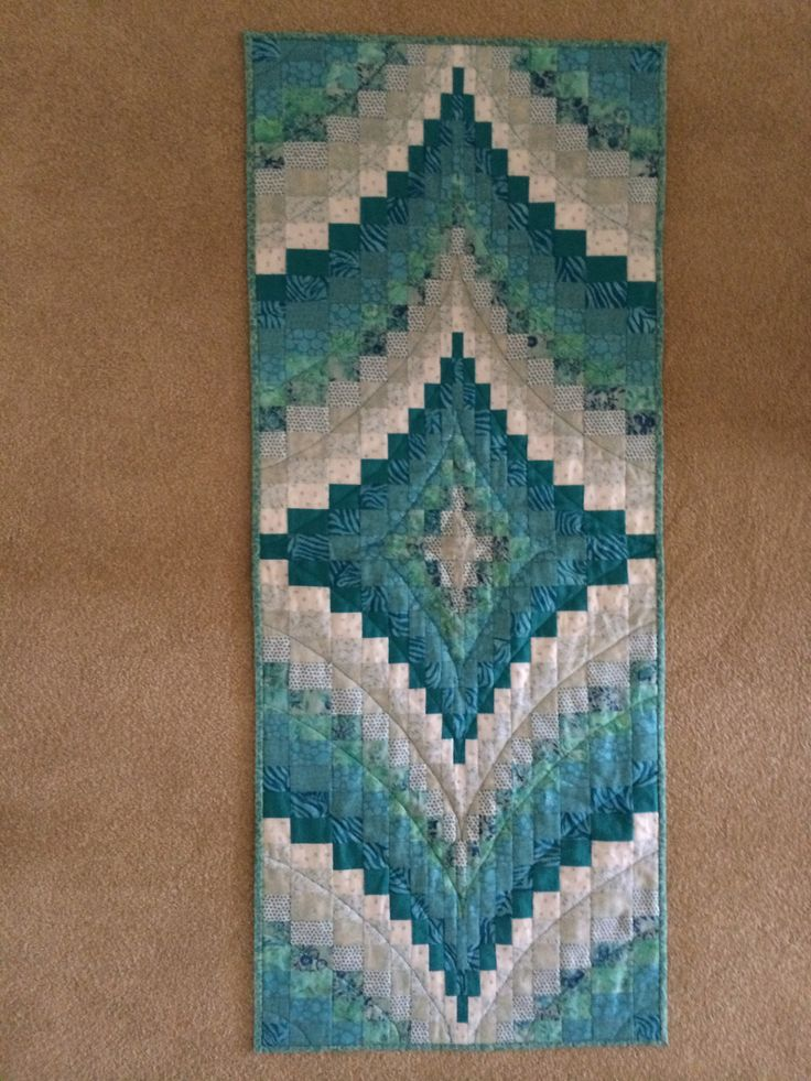 Bargello table runner. Do this with first 4 colors being red, white, red, white and then the center diamond is blues w/gold center...maybe.