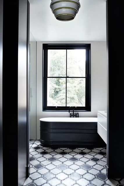 This glamorous monochrome bathroom designed by Suzy Hoodless has been tiled with 'Lantern' tiles from Popham Design.