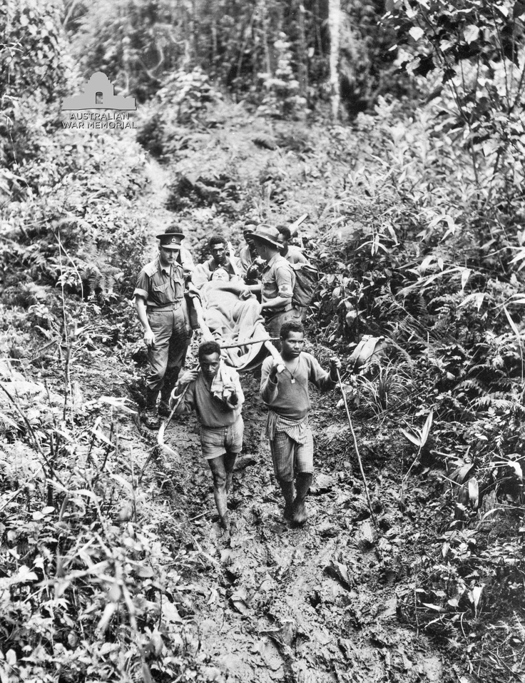 'The Fuzzy Wuzzy Angels' of Papua New Guinea helping an injured soldier during WWll.