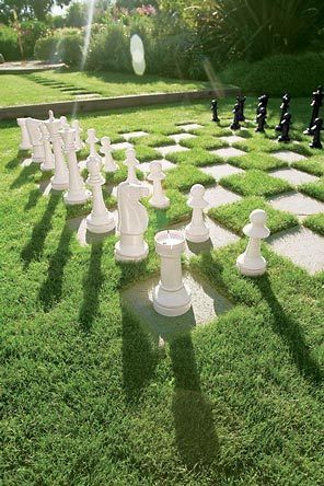 """""""This is a simple, formal garden with a big chess set,"""" says Halstead of the area just off the front porch."""