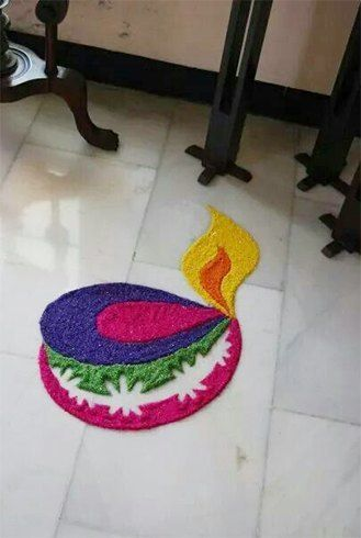 Simple Diya Rangoli Design                                                                                                                                                                                 More