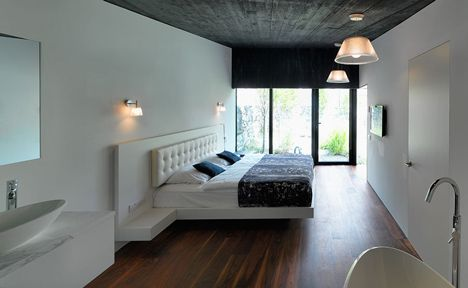 "Love the wood floor and the ""floating bed"" look"