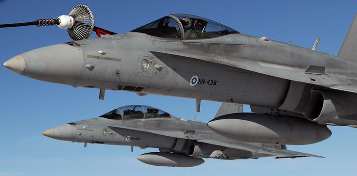 Finland steps up air defense following airspace incursions by Russian planes. F18 refueling