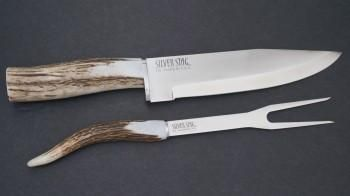 This Silver Stag Carver Set is from the Chuck Wagon Series and features D2 steel with Elk or Deer antler handles and includes a Wood Presentation Box.  The Chuck Wagon Series features the Carver Set, Kitchen Set, Ranch Steak Knife Set, & Chef Pro.   These are exceptional culinary tools that will impress the most selective professional chef, or weekend barbeque cowboy. They are impressive tools and will compliment any cooking environment.
