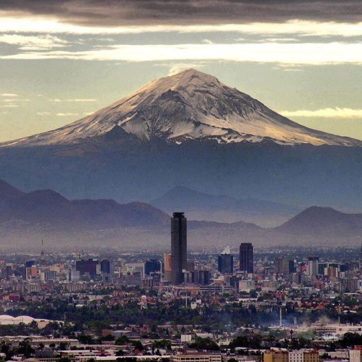 Mexico City with the Popocatépetl Volcano in the background