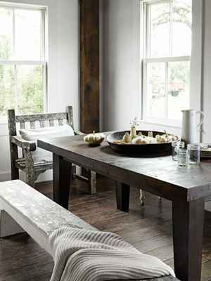 Rustic White Dining Room  In this northern California home's dining room, a Smith & Hawken chair and two wooden benches provide seating at a table that the homeowner made. The fir floorboards were reclaimed from a pea-shelling barn.