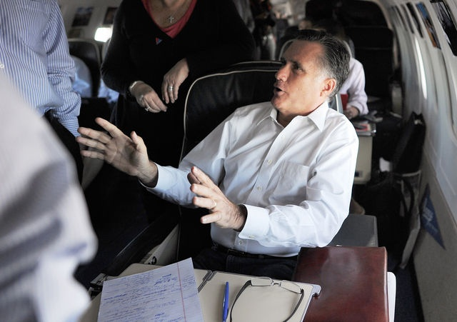 #37 Oct. 1-Romney Seeks to Burnish Image as Man of Vision in Debate;    U.S. Republican presidential candidate Mitt Romney confers with advisers on board his campaign plane on October 1, 2012. Photograph: Jewel Samad via AFP/GettyImages