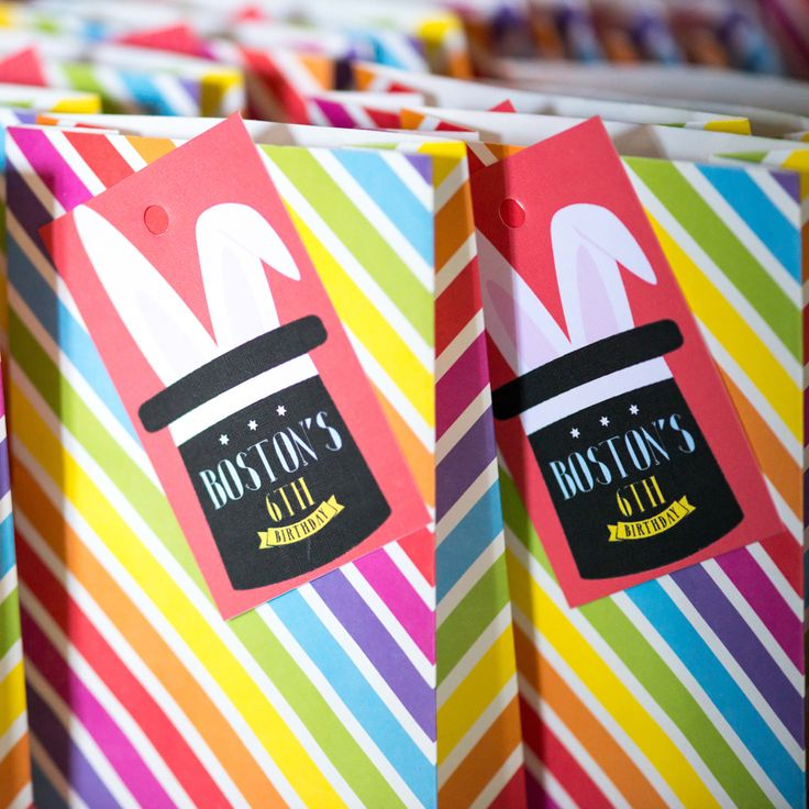 Magic party favour bags with personalised thank you tags for the kiddies to take home. You could fill these with fun games, crayons and a mixture of lollies.