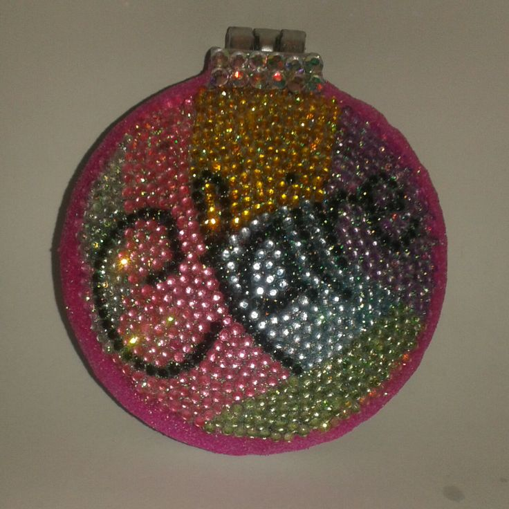 A compact mirror and folding out hairbrush one of a kind design.