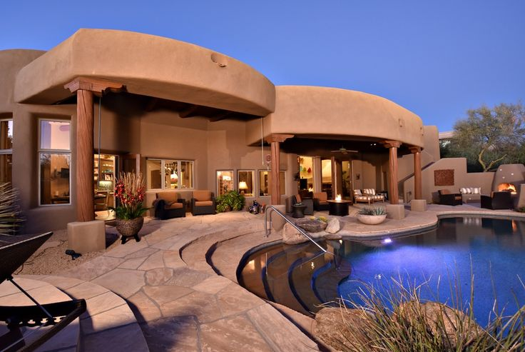 Southwestern Swimming Pool with exterior stone floors, Fire pit, outdoor pizza oven