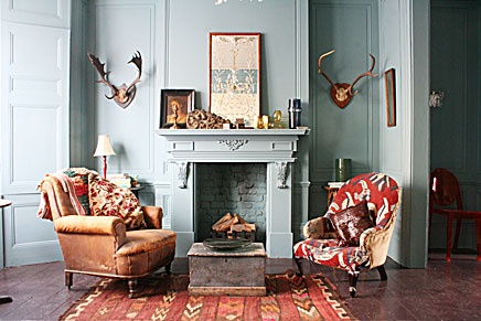 Aqua, red, brown, burnt orange, rustic living room. Awesome fireplace!