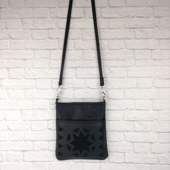 Black leather cross body bag with suede detail by WOLF BLOSSOM