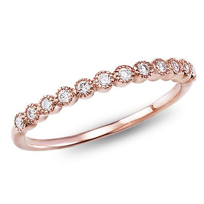 My favorite band: This 14K rose gold diamond band features twelve bezel-set diamonds strikingly linked together for a vintage look. Click on the picture for more details.