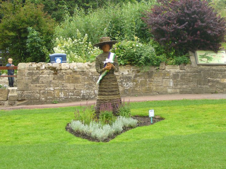 A wicker statue of Emily Wilding Davison was installed  in Carlisle Park.  Morpeth Town Council, part of the Morpeth in Bloom Team, commissioned the statue from sculptress Anna Turnbull (Biteabout Arts).