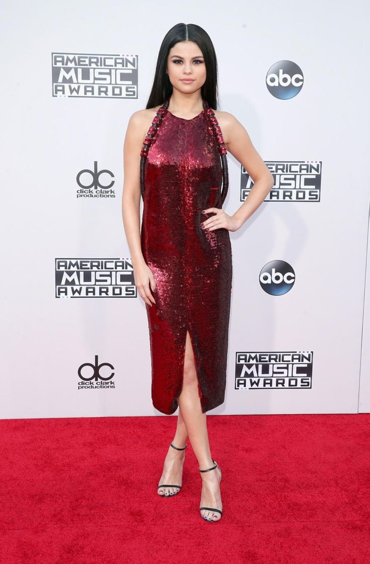 Selena Gomez dazzled in a red sequin Givenchy dress and Jimmy Choo shoes at the American Music Awards 2015 #ama #SelenaGomez