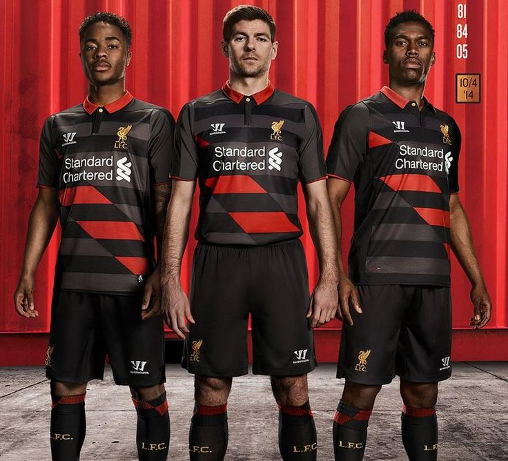 Liverpool players showing off the 3rd kit