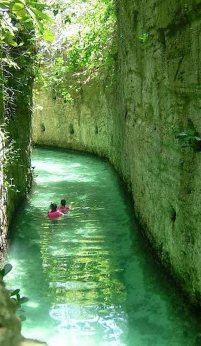 Explore underground rivers and ancient ruins at Xcaret archaeological park