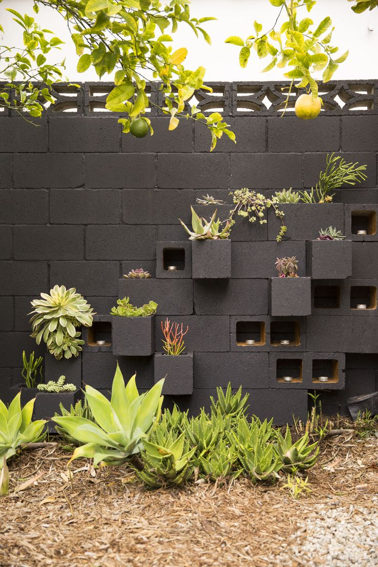 Garden Block Wall Ideas block retaining walls will last a lifetime because they are concrete At Home With Caroline Lee In Los Angeles California