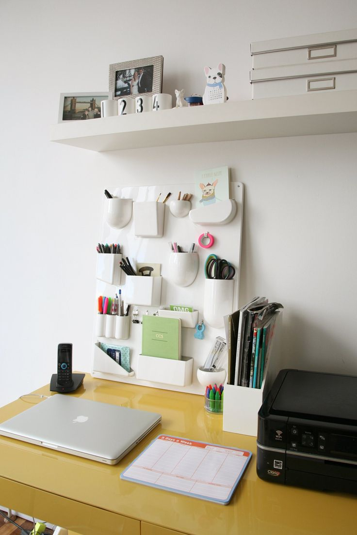 vertical desk organizer! (And if you can't install shelves, a tall organizer like the one above that uses vertical space is renter-friendly.)