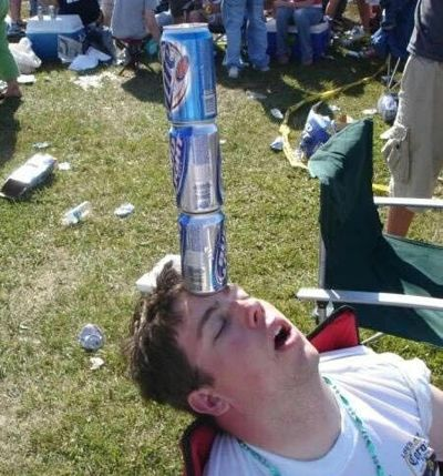 Passed out balancing empty beer cans on forehead