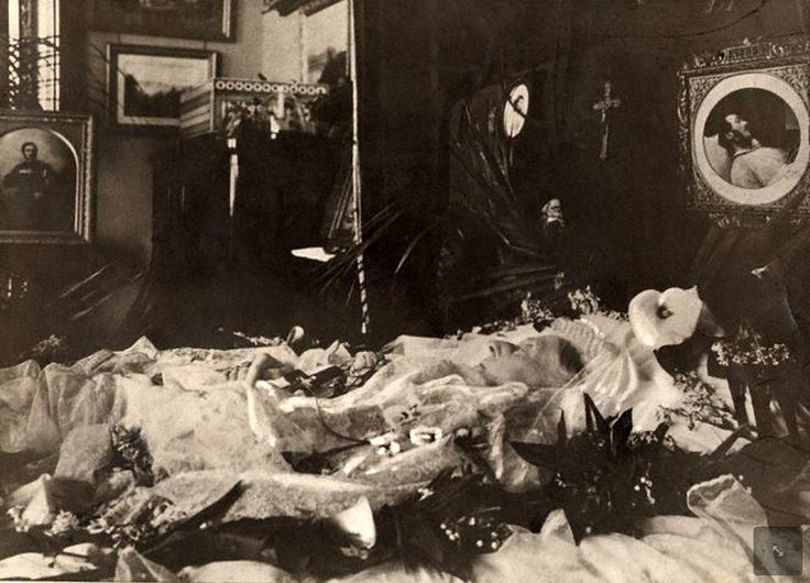 Queen Victoria's body laid for viewing on her bed at Osborne House, after her death on 22 January 1901.