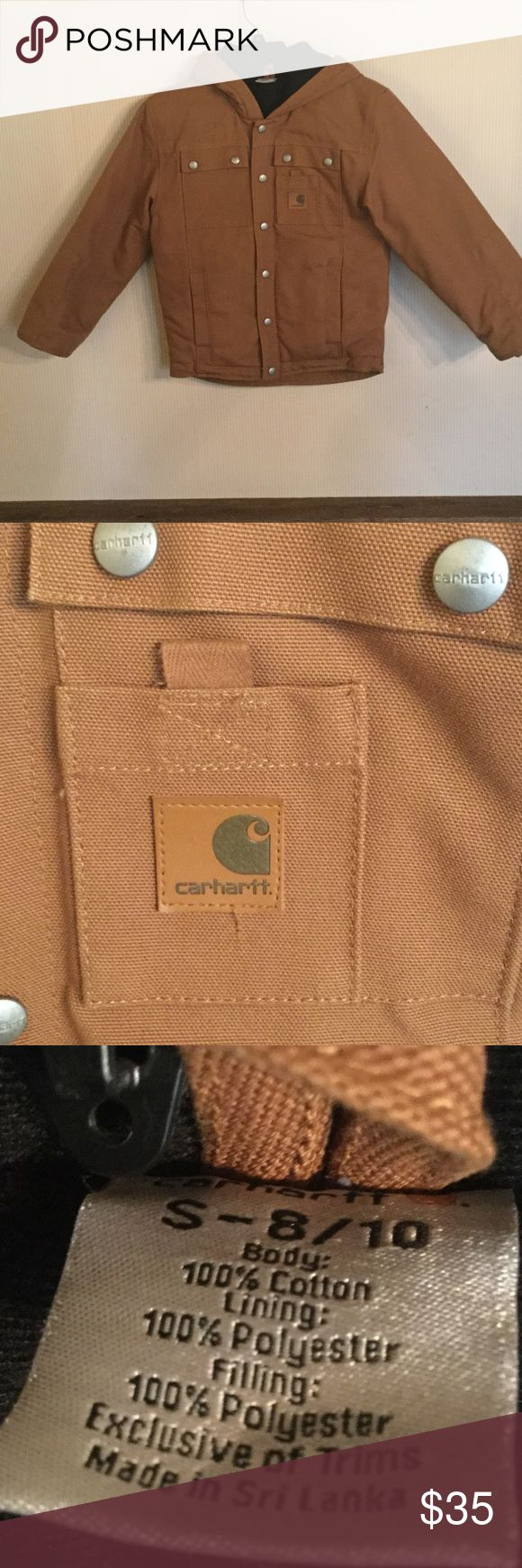 """Boys Carhartt Coat Boys Carhartt coat. Worn only 3 times. Has a hood and lots of pockets. Lined with very warm material. Silver toned snap buttons. Reasonable offers considered. Does have a """"B"""" on back of tag!!! Carhartt Jackets & Coats"""