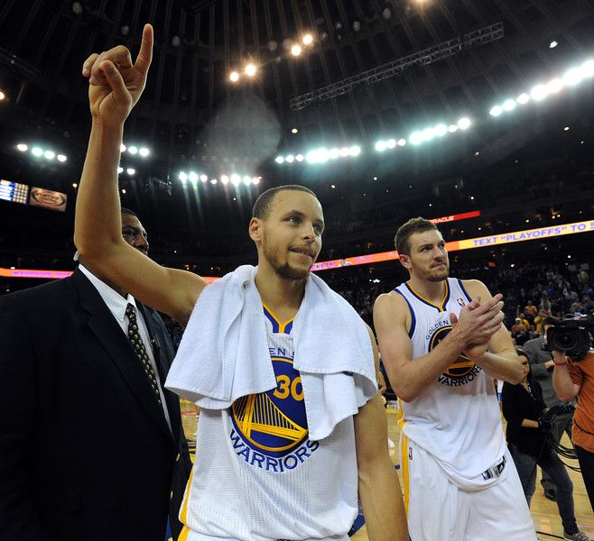 Description of . The Golden State Warriors' Stephen Curry and David Lee (10) acknowledge the crowd after clinching a playoff spot against the Minnesota Timberwolves at the Oracle Arena in Oakland, Calif., on Tuesday, April 9, 2013.(Dan Honda/Staff)