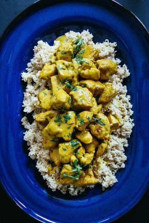 #23 Chicken Curry:      4 boneless skinless chicken breasts 4 tablespoons yellow curry powder 1 teaspoon fine salt 1 tablespoon vegetable oil 1 1/2 cups heavy cream 1 tablespoon cilantro - optional