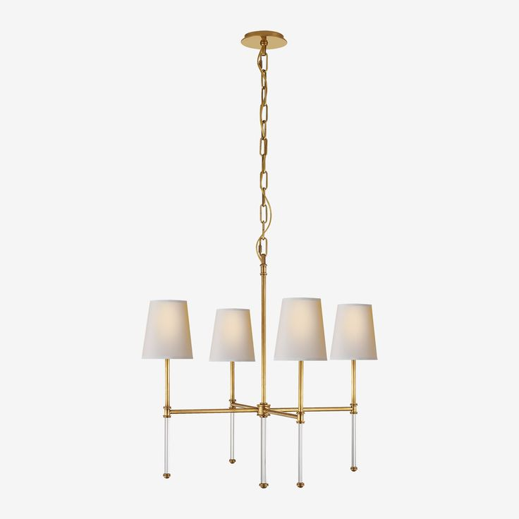 The Camille Chandelier in Hand-Rubbed Antique Brass with Natural Paper Shades by Suzanne Kasler • The Camille Chandelier has strong, clean lines and manages to mix contemporary and classic beautifully. This chandelier is crafted in brass finishes, featuring elongated glass rods and finished with neutral paper shades.