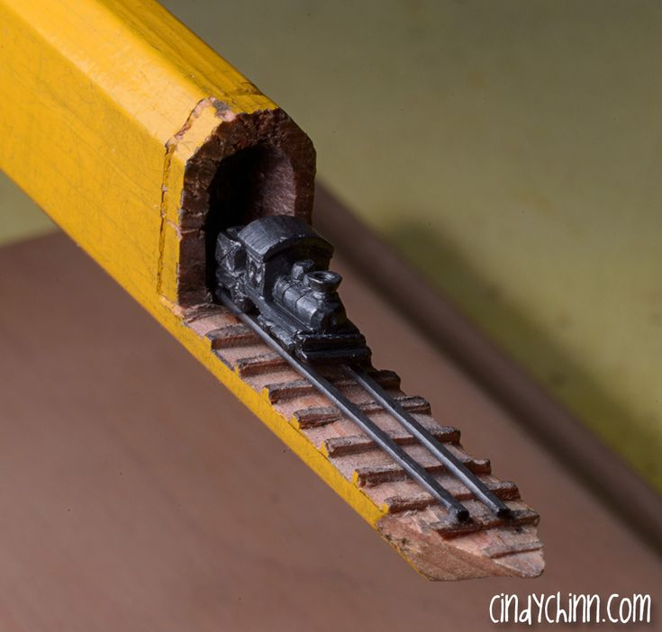 Wonderfully Detailed Train & Trestle Expertly Carved Into the Graphite of a Carpenter Pencil