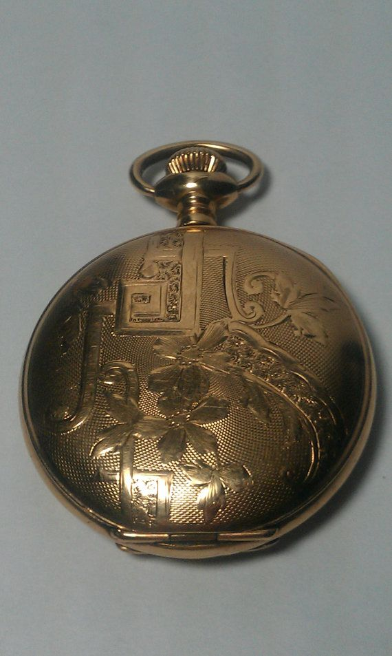 This pocket watch is in a beautiful gold case. Its movement is Illinois Watch Co. 15 Jewels. The serial # dates this watch at 1915. The watch ticks