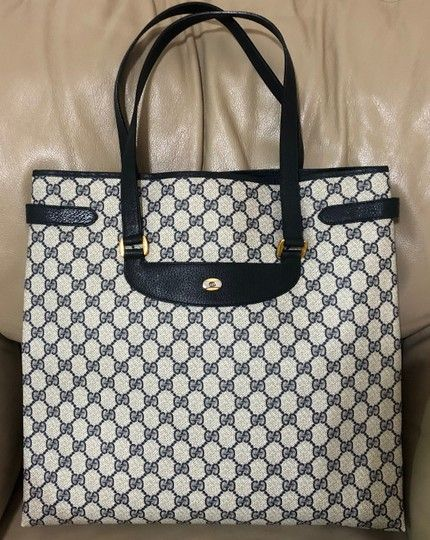 8d862e2576a Gucci Vintage Navy Monogram Leather Laptop Shopper Blue Canvas Tote. Get  one of the hottest styles of the season! The Gucci Vintage Navy Monogram  Leather ...
